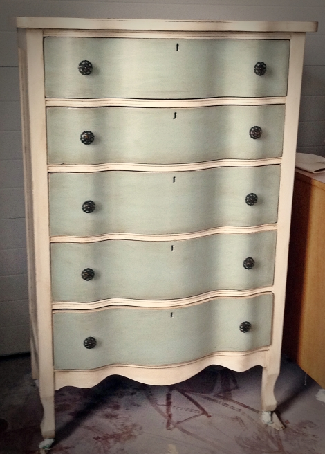 Serpentine oak dresser