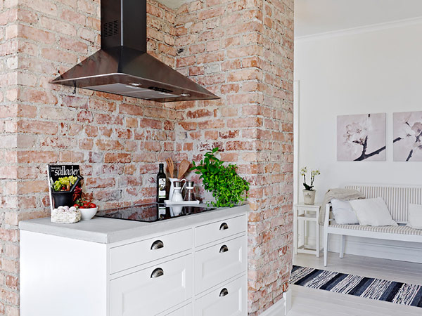 Gorgeous  kitchen countertop design in apartment with exposed brick. How to get the Vintage Farmhouse Look  Think Fixer Upper